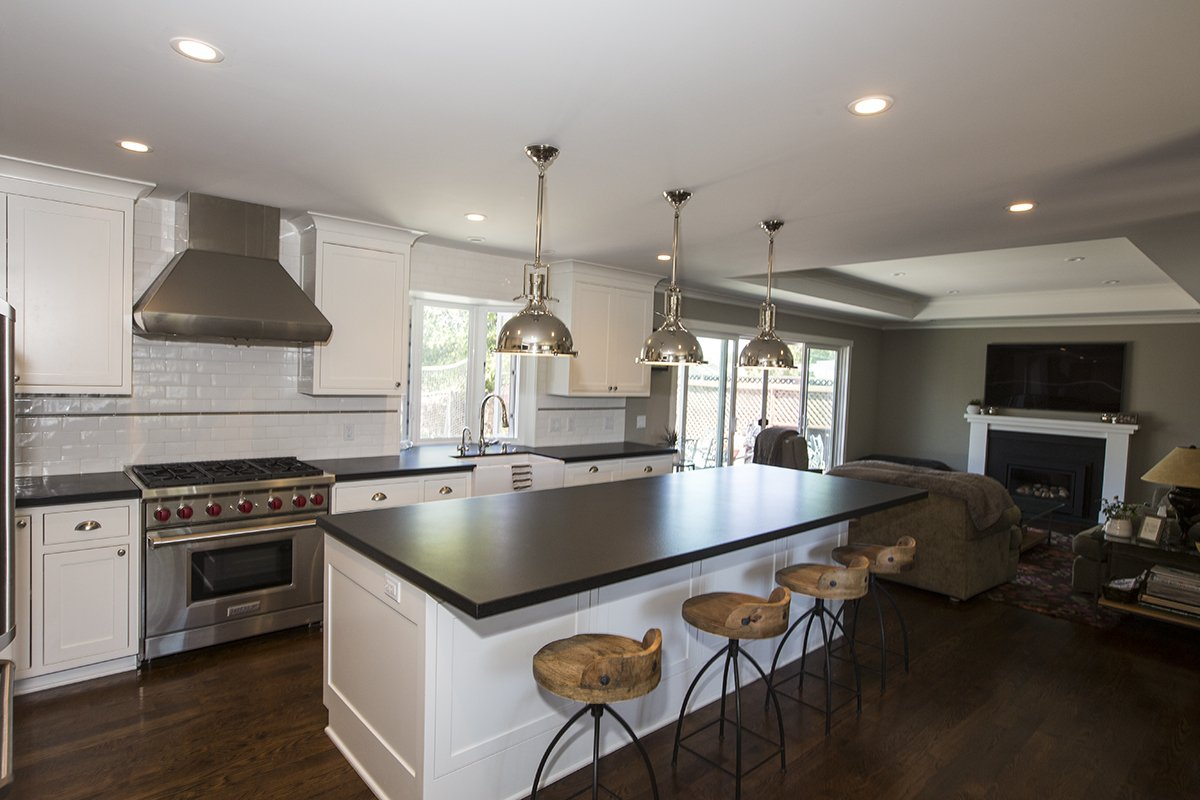 Cabrian Park - contemporary kitchen with large gas stove and hood