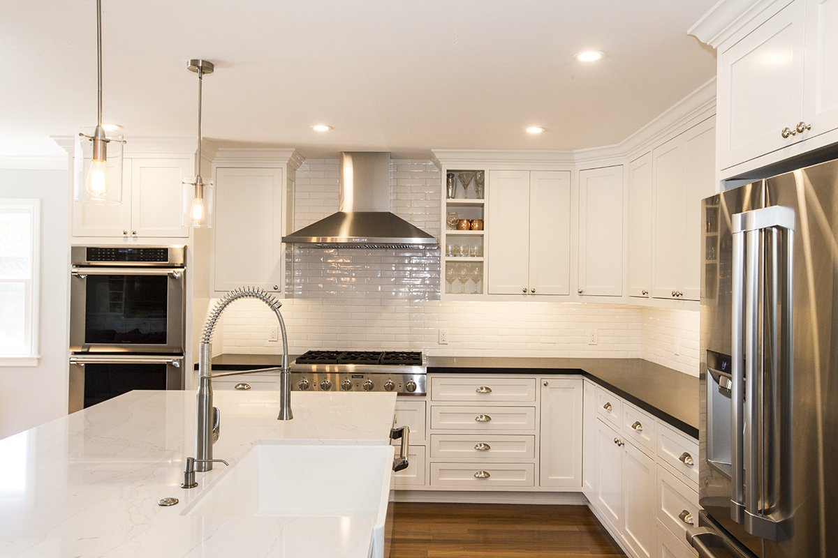 Remmington - white cabinet and subway tile in kitchen remodel