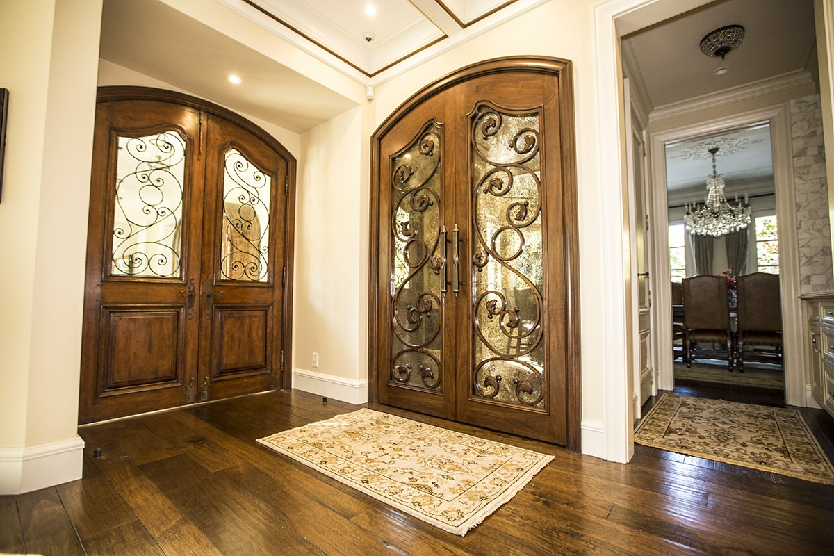 Atherton - by Mission City - ornate custom woodworking for hall closet and entry