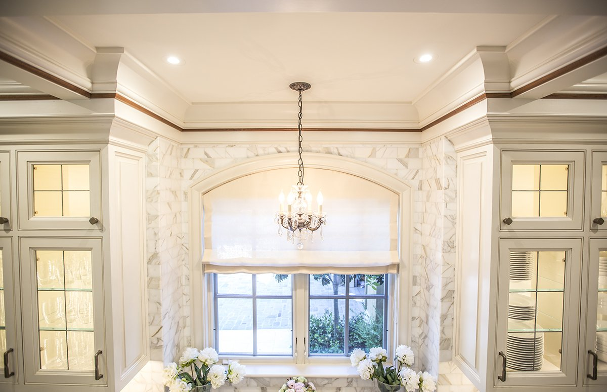 Atherton - by Mission City - arched kitchen window with custom stonework
